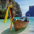 Traditional longtail boats in the famous Maya bay of Phi-phi Leh — Stock Photo #41004649
