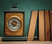 Old books on a wooden shelf and watches — Stok fotoğraf