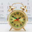 Stock Photo: Alarm clock and calendar