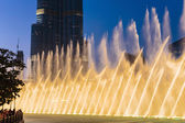 Night view Dancing fountains downtown and in a man-made lake in  — Stock Photo