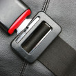 Seat belt on black leather chair — Stock Photo #41668843