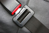 Seat belt on a black leather chair — Stock Photo