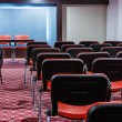 Rows of red chairs in empty conference hall — Stock Photo #41925661