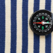 Compass on a sailor shirt — Stock Photo