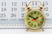 Alarm clock and calendar — Stock Photo