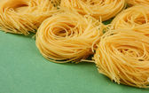 Tagliatelle pasta background on the green background — Stock Photo
