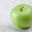 Green apple on a binary code — Stock Photo #47540027