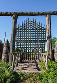 Old wooden fortification wall of the fort — Stock Photo