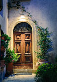 Entrance to the old Italian house at night. — Stock Photo