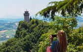 Tourists take pictures of the castle of San Marino — Stock Photo