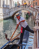 Gondolier rides gondola — Stock Photo