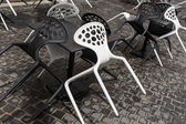 Plastic chairs in a street cafe — Stock Photo