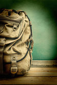 Old travel backpack on the floor — Stock Photo