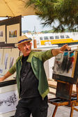 Artist sells paintings  in Venice, Italy — Stock Photo