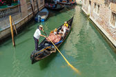 Gondolier rides gondola on Venice canals — Stock Photo