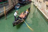 Gondolier rides gondola on Venice canals — Stock Photo