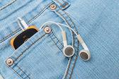 Headphones in the pocket — Stock Photo