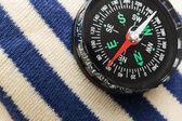 Compass on a sailor shirt — Stock Photo