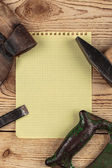 Old carpentry tools and a piece of notebook — Stock Photo