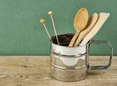 Wooden kitchenware in metal jug — Stock Photo