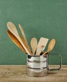 Kitchenware in metal jug — Stock Photo