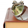 Golden alarm clock and magnifying glass on the book isolated — Stock Photo #8541776