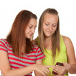 Portrait of lovely young women using mobile phone together — Stock Photo #9748160