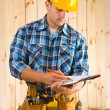 Stock Photo: Worker write on clipboard