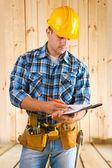 Worker write on clipboard — Stock Photo