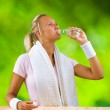 A girl drinking water from bottle — Stock Photo #12501104