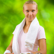 A girl at table with dumbbell — Stock Photo
