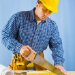 Royalty-Free Stock Photo: Men cutting plank