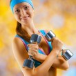 A sports girl with two dumbbells — Stock Photo #14607979