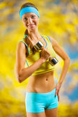 A beautyful sports girl with dumbbell — Stock Photo