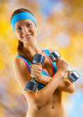 A sports girl with two dumbbells — Stock Photo