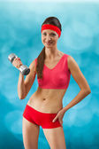 A beautyful sporty girl with dumbbell — Stock Photo