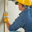 Man drilling wall — Stock Photo
