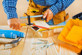 Worker fixes two wooden planks — Stockfoto