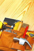 Tools in belt on table — Stock Photo