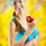 A girl eating an apple — Stock Photo