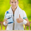 A guy holding big bottle of water - Stock Photo