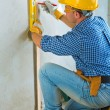 A worker layering on concrete wall — Stock Photo