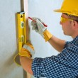 A contractor do layering on concrete wall - Stock Photo