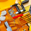 Building tools in belt and hardhat - Foto Stock