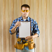 A worker holds clipboard — Stock Photo