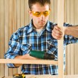 Young men works with screwdriver — Stock Photo