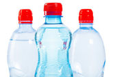 Three tops of bottles of water — Stock Photo