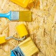 Paint tools on plywood — Stock Photo #23071044