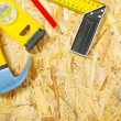 Construction tools on plywood — Stock Photo #23071070