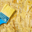Paintbrush on plywood — Stock Photo #23071482